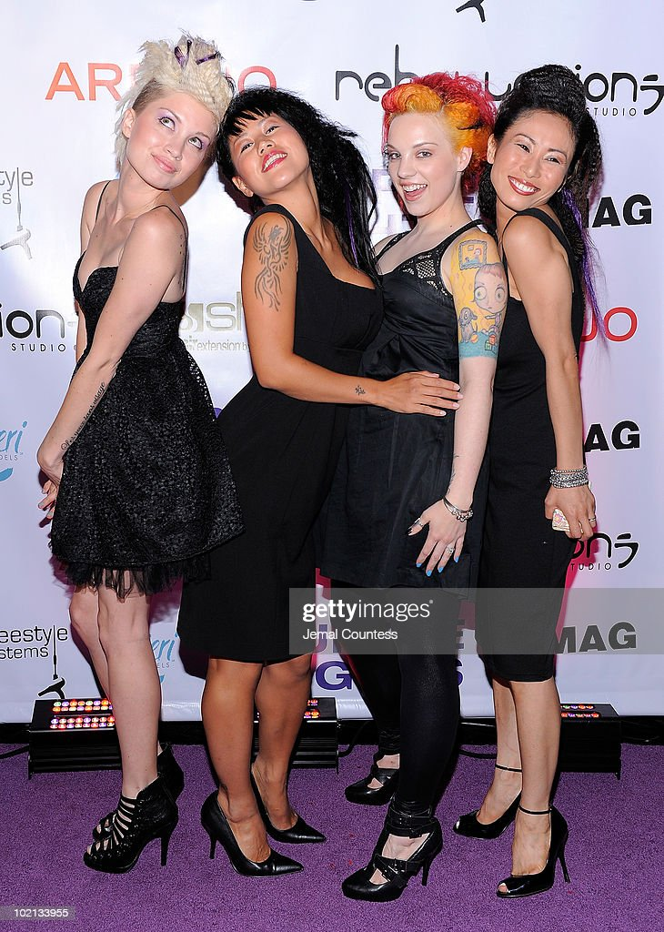 Hair models pose for a photo during 'Purple Nights', a fund raiser presented by the Project Purple Umbrella Fund to raise money for Woman Rising, the only battered woman shelter in Hudson County, New Jersey, held at the W Hoboken on June 15, 2010 in Hoboken, New Jersey.