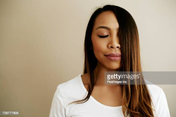 hair of asian woman covering half of face - beautiful filipino women stock photos and pictures