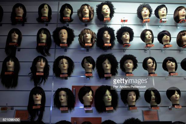 Hair pieces are on display in a shop on October 5 2012 at Maponya shopping Mall Soweto South Africa Maponya is one of several new shopping malls in...
