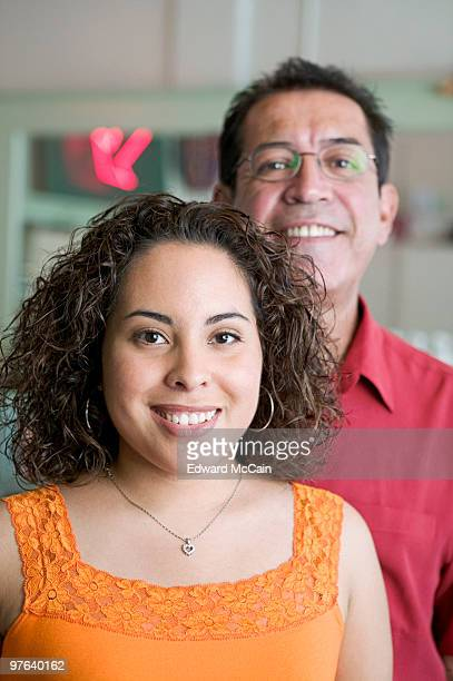 Hair salon owner with his daughter