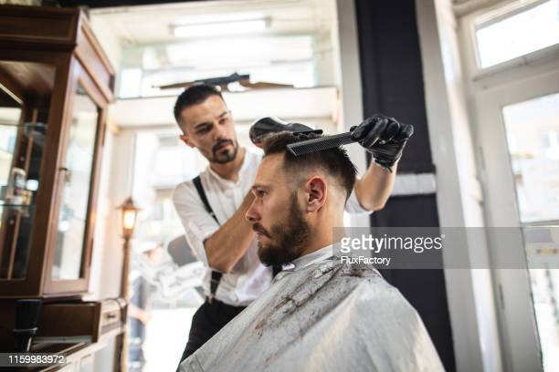 hair styler adding some finishing touches - drying stock pictures, royalty-free photos & images