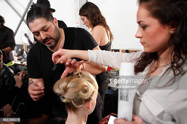 Hair stylist Amit Abraham prepares a model backstage at L'Oreal Professionnel Backstage at Bibhu Mohapatra at The Pavilion at Lincoln Center on...