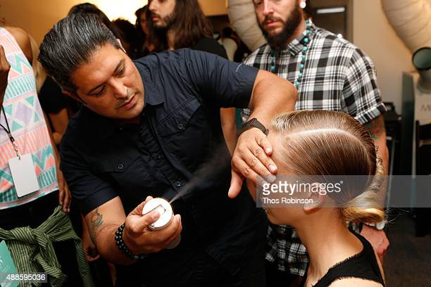 Hair stylist Amit Abraham prepares a model backstage with L'Oreal Professionnel hair products at Bibhu Mohapatra Spring 2016 during New York Fashion...
