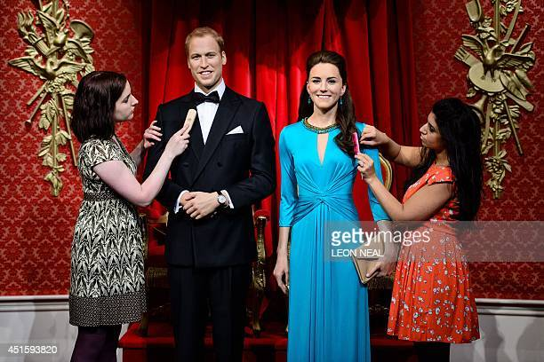 A hair stylist and technician pose with the newly relaunched wax figures of the Duke and Duchess of Cambridge at Madame Tussauds tourist attraction...