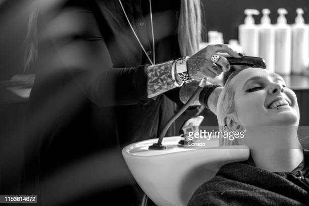 hair stylist client - bleached hair stock pictures, royalty-free photos & images