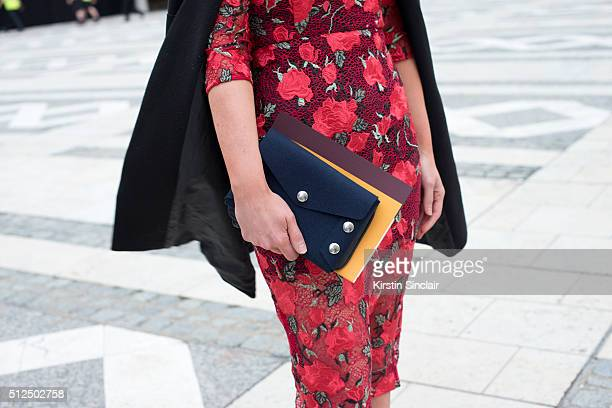Hair stylist Debbie Cooper wears a Topshop dress and a Mulberry bag on day 3 during London Fashion Week Autumn/Winter 2016/17 on February 21 2016 in...