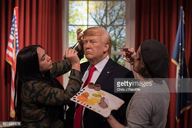 Hair stylist Gemma Sim and make up artist Chris Gargiulo put finishing touches in place as Madame Tussauds unveils a wax figure of PresidentElect...