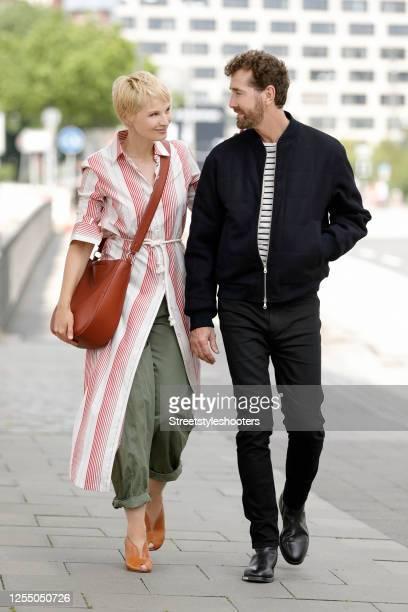 Hair stylist Joerg Oppermann wearing a black jacket by Dries van Noten, a black and white striped t-shirt by Dries van Noten, black pants by Celine...