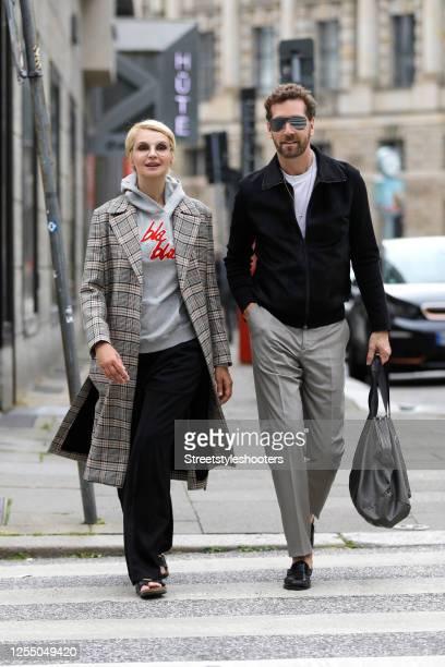 Hair stylist Joerg Oppermann wearing a white t-shirt by Prada, a black jacket by Prada, grey pants by Armani, black shoes by Celine and a black bag...