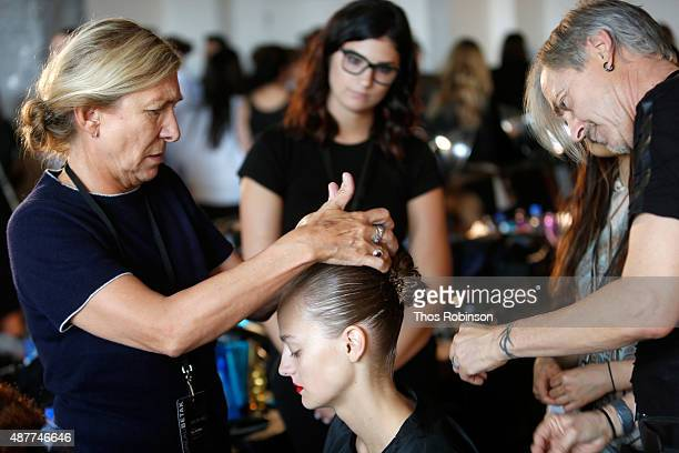Hair stylist Odile Gilbert prepares a model backstage with Kerastase Paris at the Jason Wu S/S 2016 fashion show during Spring Studios on September...