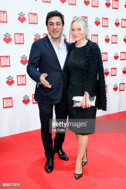 Hair stylist Shan Rahimkhan and his wife Claudia Rahimkhan attend the 'Ein Herz fuer Kinder Gala' at Studio Berlin Adlershof on December 9 2017 in...