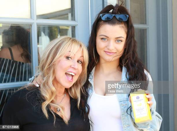 Hair stylist Tina Cassaday and musician/actress Laci Kay with BananaBanana by Tina Cassaday Beverly Hills conditioner at A Day of IMPRESSIONS with...