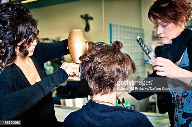 Hair stylists working in salon