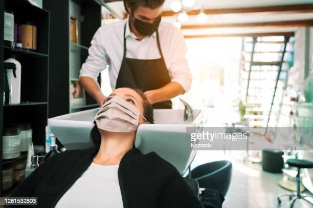 hair washing during pandemic - washing hair stock pictures, royalty-free photos & images