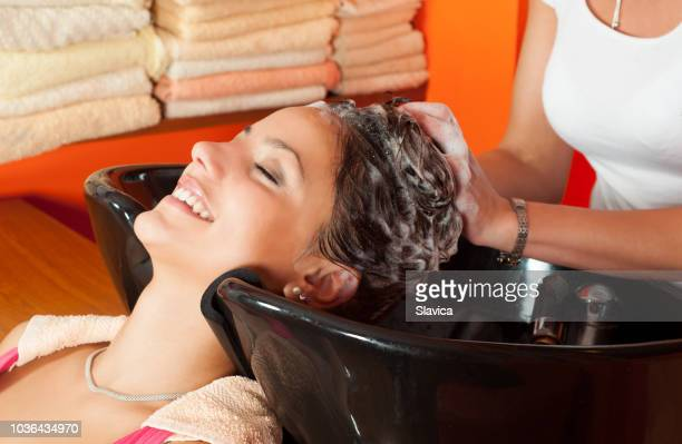 happy woman washing hair hair salon