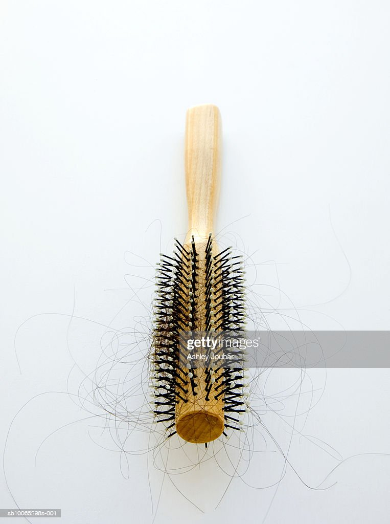 Hairbrush containing loose hairs : Foto stock
