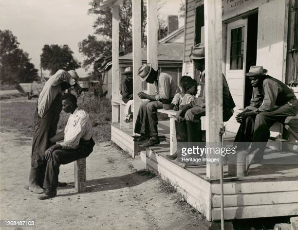 Haircutting in Front of General Store and Post Office on Marcella Plantation Mileston Mississippi 1939 Artist Marion Post Wolcott