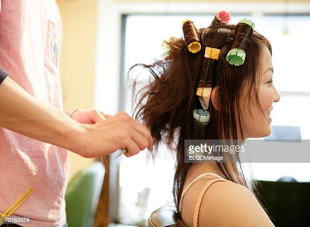 Hairdresser Applying Hair Dye to a Woman's Hair