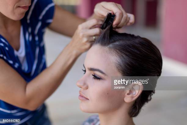 Hairdresser applying hairspray