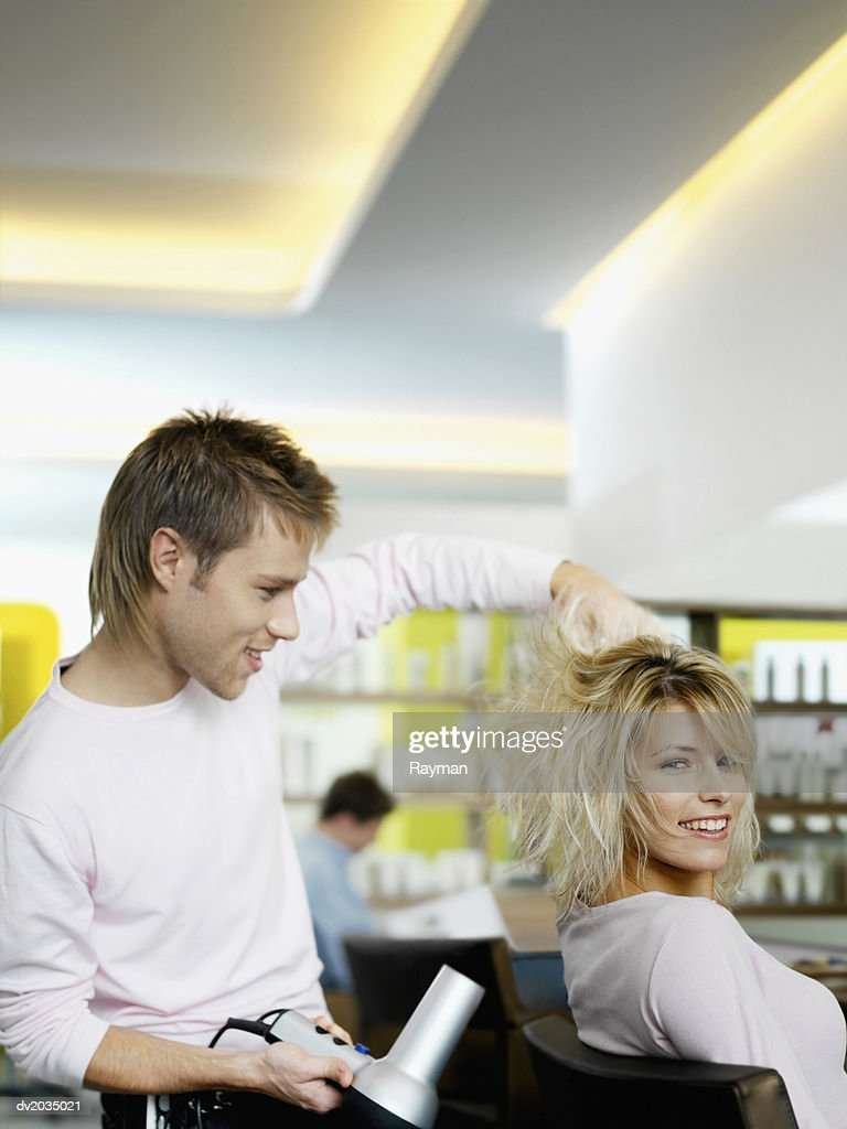 Hairdresser Blow Drying a Woman's Hair : Stock Photo