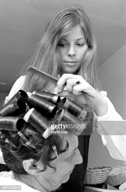 Hairdresser Carrie White putting rollers in client's hair circa September 1968 in Los Angeles California