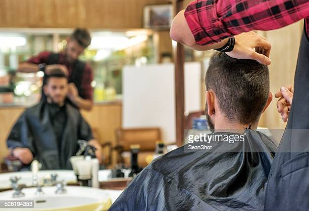 Hairdresser Checking Customer's Hair