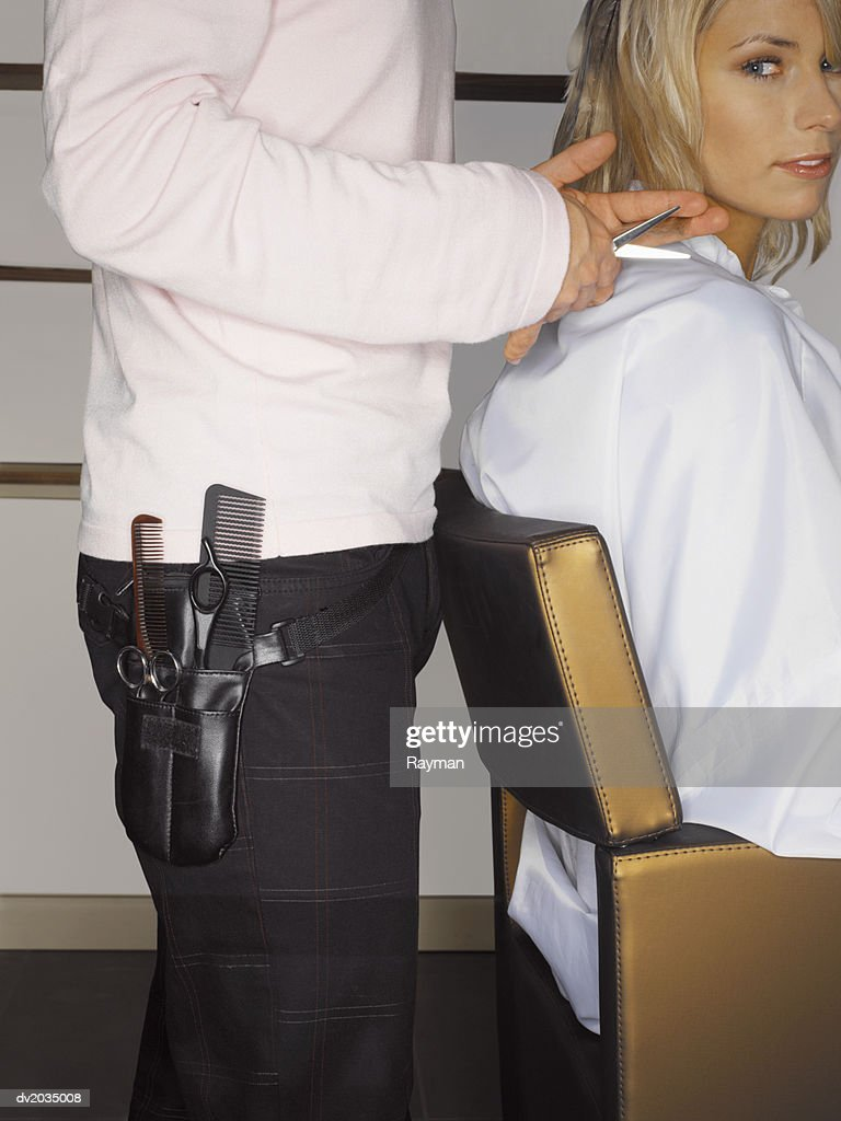 Hairdresser Cutting a Woman's Hair : Stock Photo