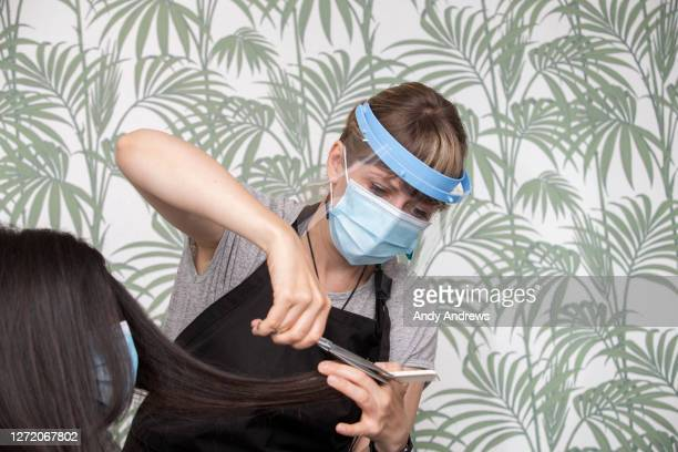 hairdresser cutting customer's hair during covid-19 - safety stock pictures, royalty-free photos & images