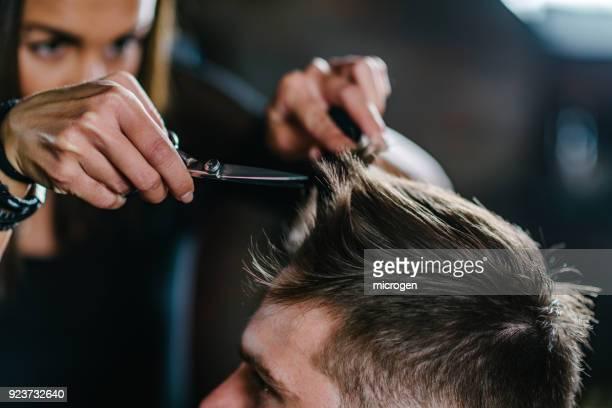 Hairdresser Cutting Man Hair At Salon