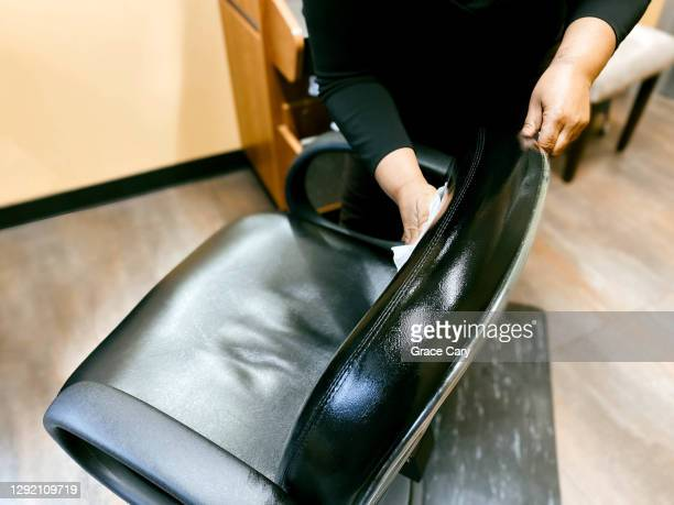 hairdresser disinfects salon chair - antiseptic wipe stock pictures, royalty-free photos & images