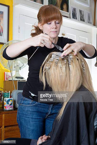 hairdresser doing highlights on client - highlights stock pictures, royalty-free photos & images