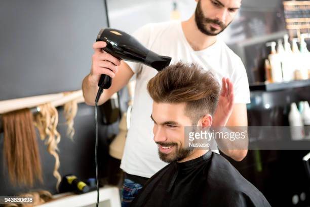 Hairdresser drying hair