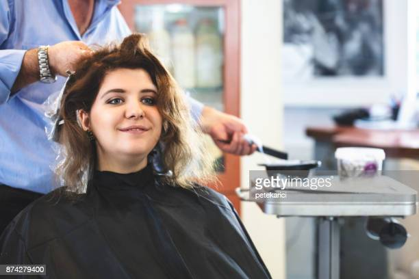 hairdresser dyeing hair of her client - highlights hair stock pictures, royalty-free photos & images