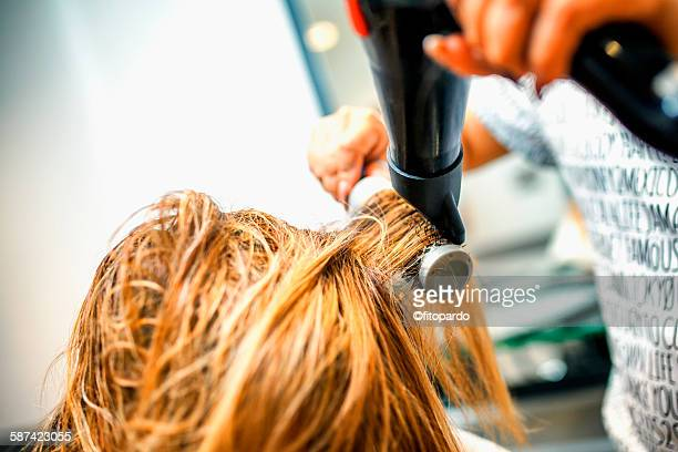 hairdresser in a salon - john nollet hairdresser stock photos and pictures