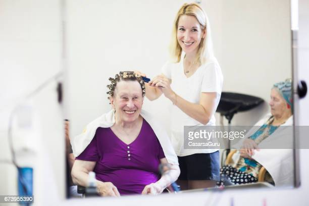 hairdresser in the nursing home - residential care stock photos and pictures