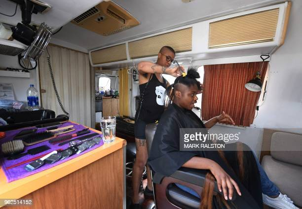 Hairdresser Madin Lopez works on the hair of a homeless client at her trailer studio in Silver Lake Los Angeles California on April 15 2018 Project Q...