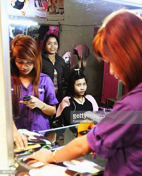 Hairdresser on a marketplace in Siem Reap Cambodia
