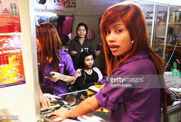 Hairdresser on a marketplace in Siem Reap on December 28 2008