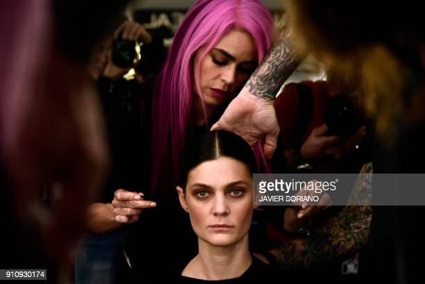TOPSHOT A hairdresser prepares a model before the presentaition of Angel Schlesser's Fall/Winter 2018/2019 collection during the Madrid Fashion Week...