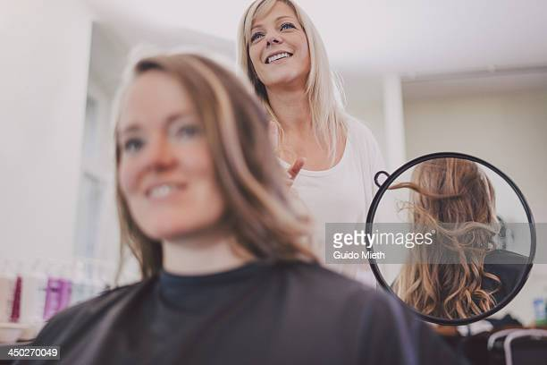 Hairdresser showing new haircut