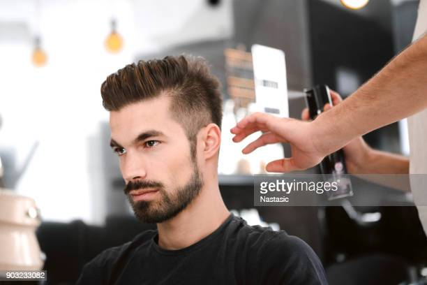hairdresser spraying hair - hairstyle stock pictures, royalty-free photos & images
