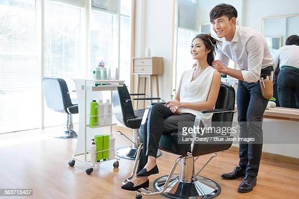 Hairdresser working on customer