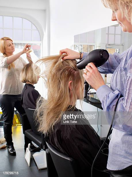 Hairdressers at work in salon