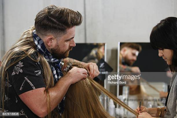 Hairdressers prepare a model backstage prior the Alexandre Vautier Spring Summer 2017 show as part of Paris Fashion Week on January 24 2017 in Paris...