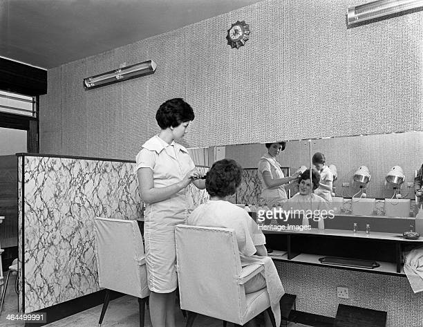 Hairdressers' salon Armthorpe near Doncaster South Yorkshire 1961 The photograph was commissioned by the company who manufactured the Formica wipe...