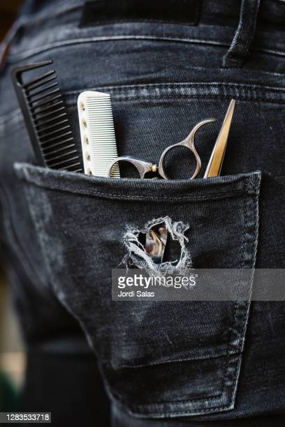 hairdresser's tools in his pocket - hands in her pants stock pictures, royalty-free photos & images