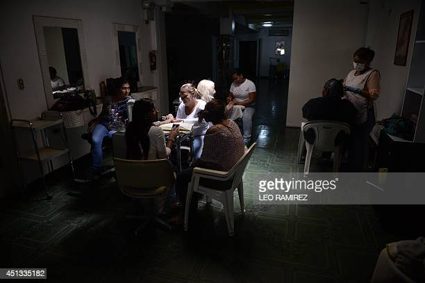 A hairdressing salon in the dark during a power cut in Caracas on June 27 2014 An extensive power cut affected Friday large sectors of eastern...