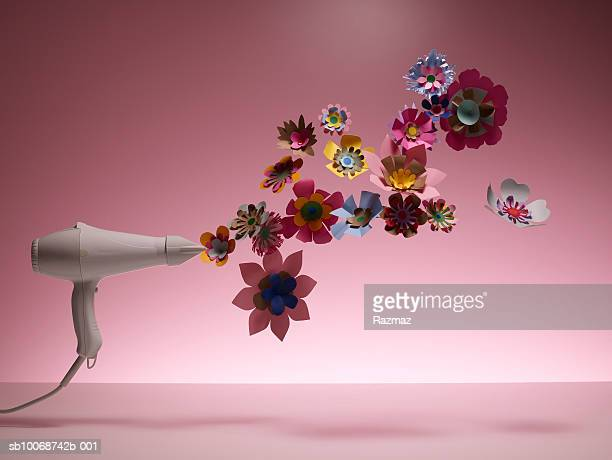 Hairdryer drying artificial flower, close-up
