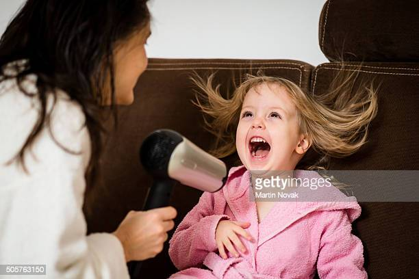 Hairdryer fun - mother and child