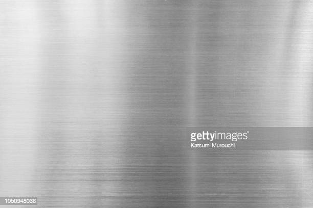 hairline steel plate texture background - metallic stock photos and pictures